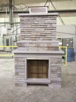 Photo of an outdoor fireplace with a Condar mesh screen installed.